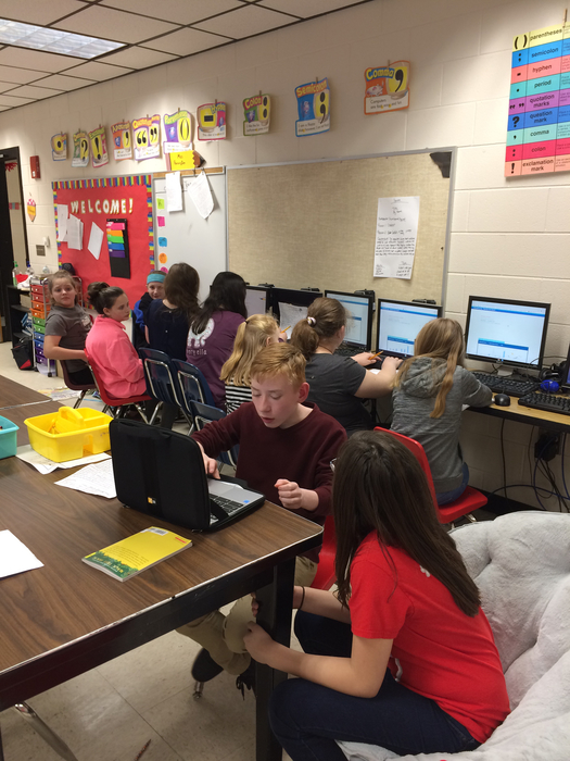 6th grade helps 5th research their states.