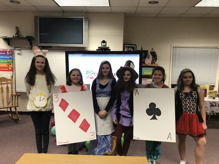 CmPS presenting comparison of Alice in Wonderland characters to Share Your Calm.