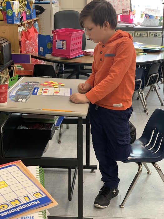 Checking his board for homophones as I read the sentences!