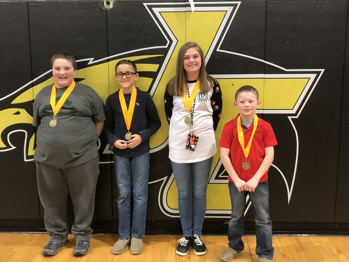 Overall Division Winners Joshua Fitchpatrick and Alex Marcum 1st Place, Abby Ramey 2nd Place, and Carson O'Bryan 3rd Place (K-3)