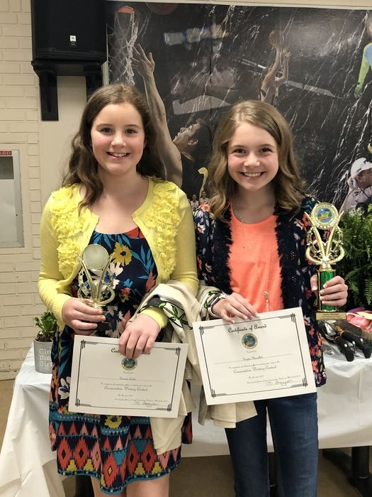 Kenadie Castle and Haylee Marsillett receive their awards at the conservation banquet