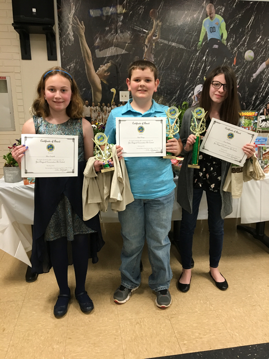 Adara Campbell, Elijah Skaggs, and Emma Salisbury receive their awards for their conservation essays