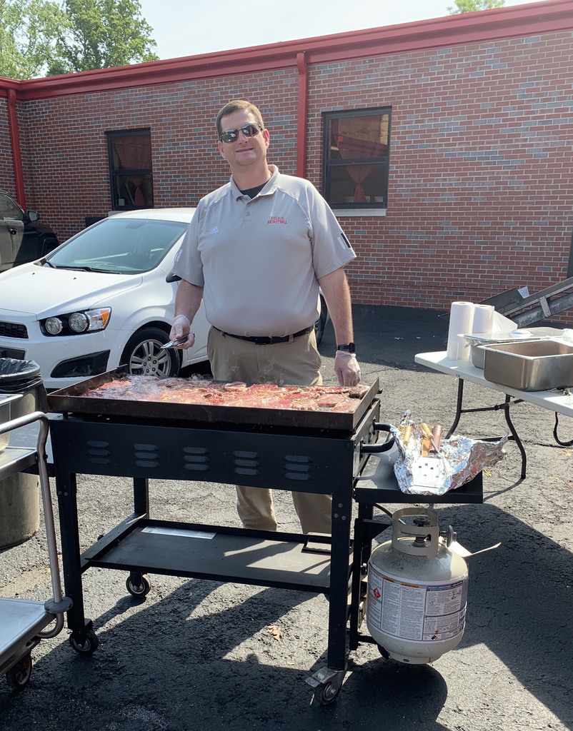 Mr. Pierce grilling steaks for students and staff.