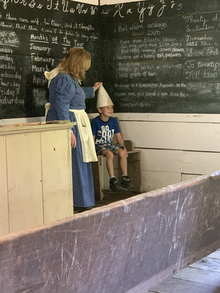 Logan in the schoolhouse.