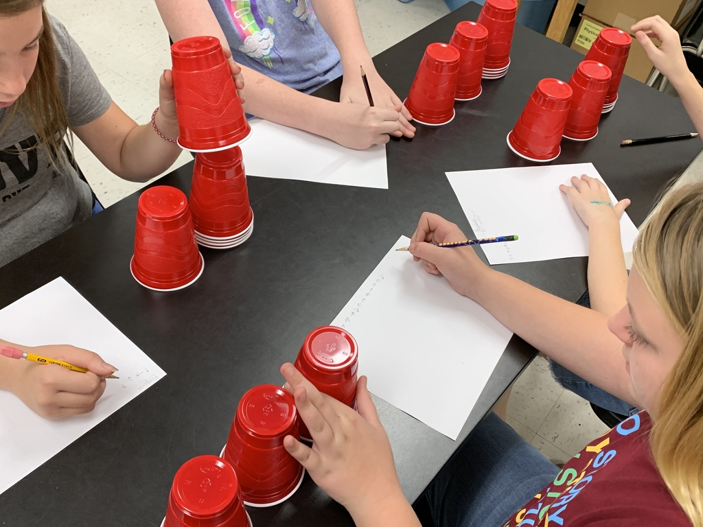 Students were writing a program for their cup stacking robots.