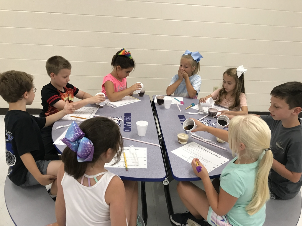 Second grade students enjoying three states of matter with ice cream floats.