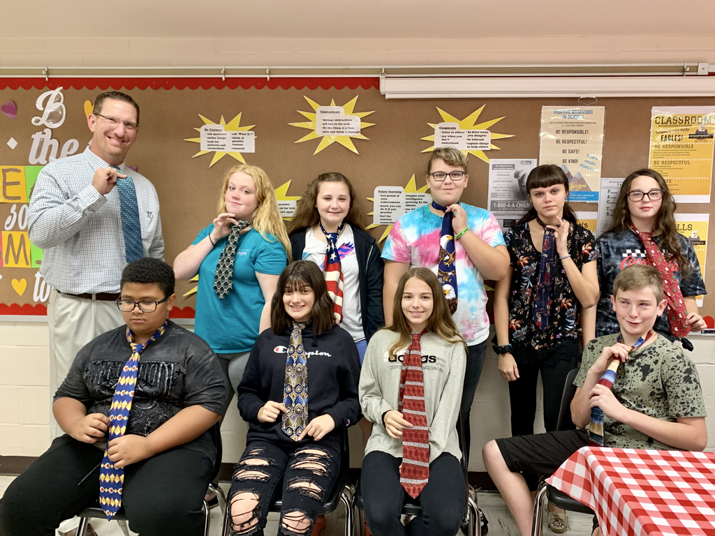 JCMS Principal Shawn Hall demonstrates how to tie a tie for Life Skills classes.