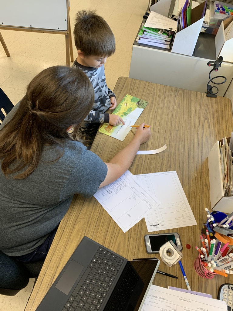 Mrs. Davis doing some individual reading with one of her students.