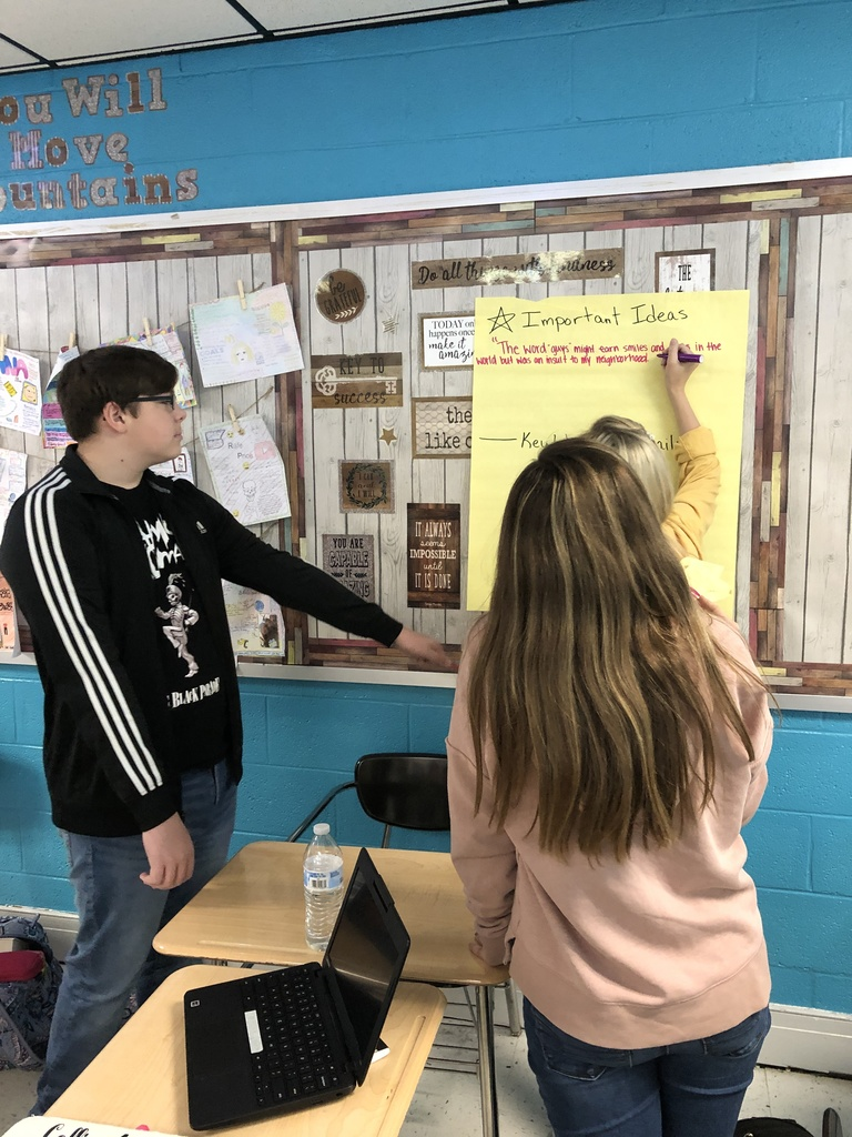 "Mrs. Moore's Advanced ELA Class has been reading a book in which the character ""Code Switches"".  They annotated an article about the topic, did a ""Camp Fire Reading"" and had a whole group discussion.  Students were very engaged in the activity and debate."