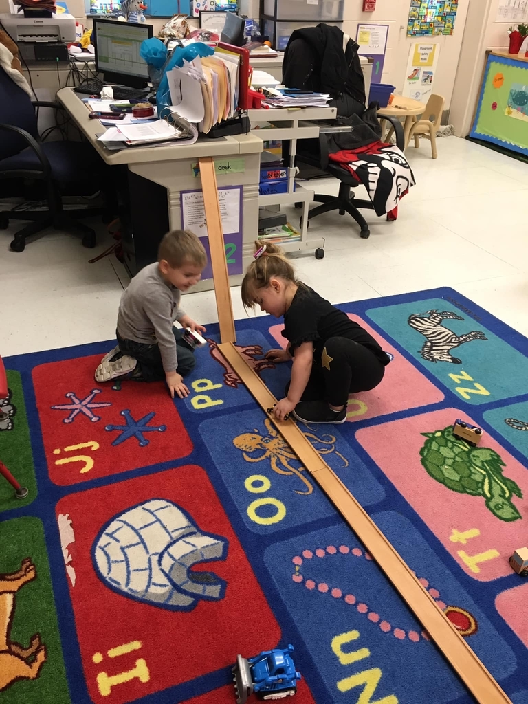 Maddix and Kennedy putting their heads together risked a ramp to run their cars on learning about gravity and speed!