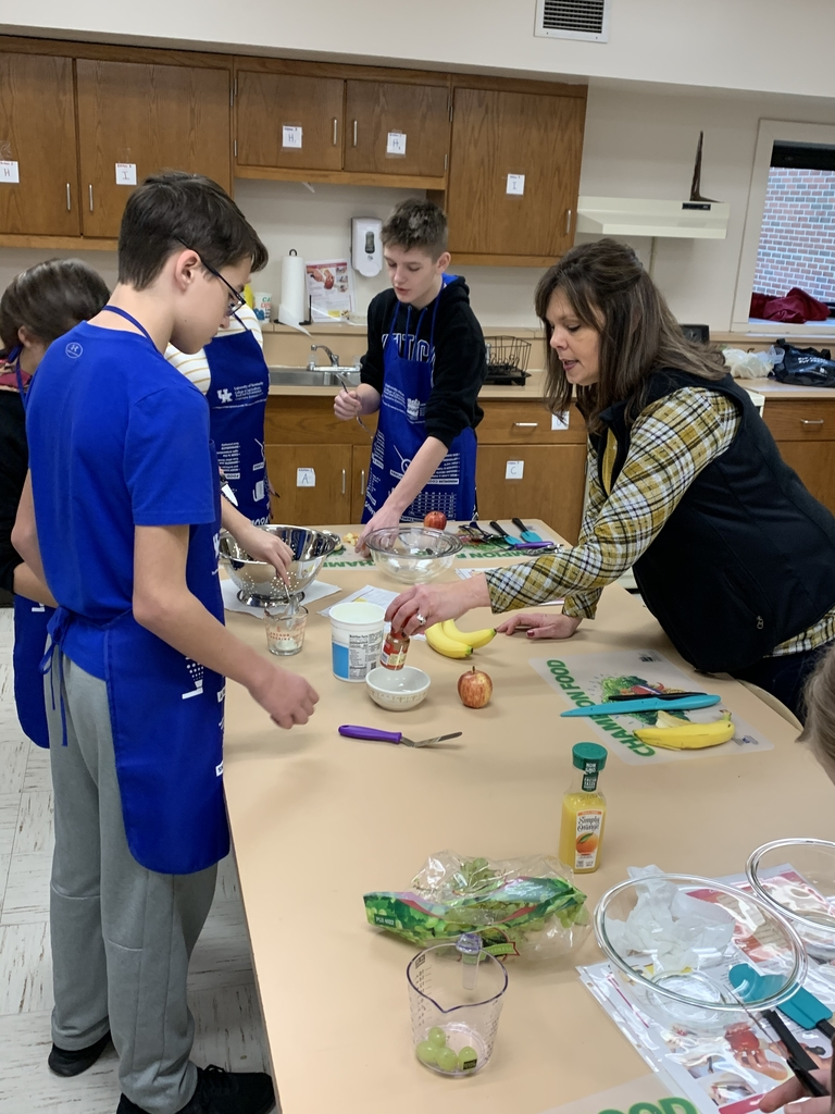Elaine Burton demonstrates knife skills/safety as Life Skills students prepared a fruit salad recipe.