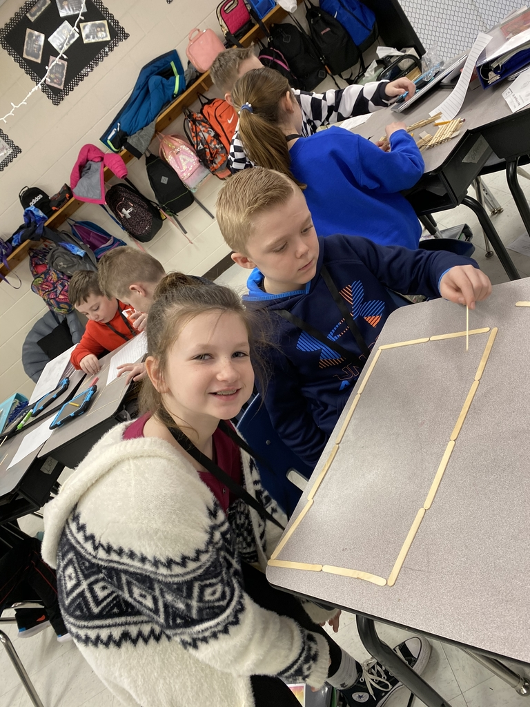 3rd grade students making shapes to match a given perimeter.